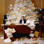 woman-buried-by-paperwork