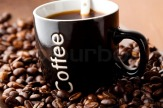 2478217-mug-of-black-coffee-with-coffee-beans