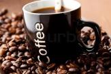 2478217-mug-of-black-coffee-with-coffee-beans